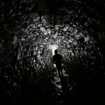 Boy in mine tunnel